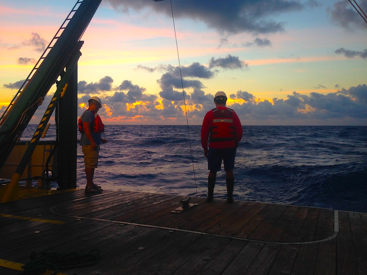 AOML scientists Pedro Pena and Robert Roddy monitor the retrieval of the CTD. Image credit: NOAA