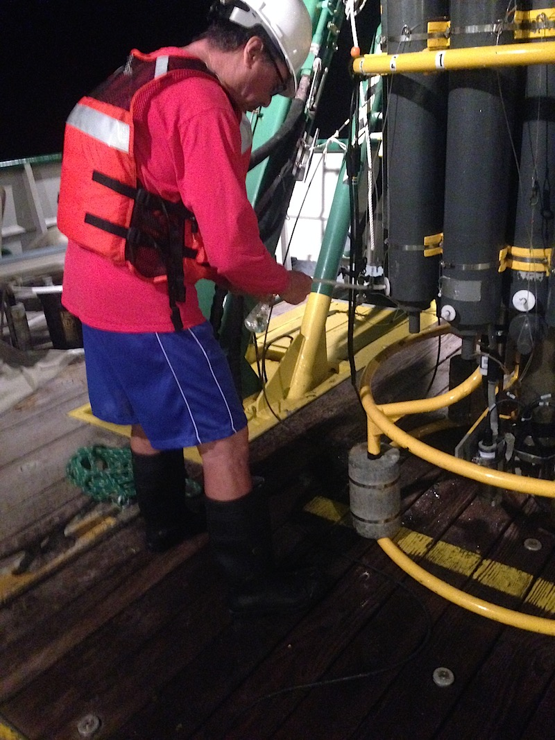 AOML scientist Robert Roddy takes a sample from a CTD cast. Image credit: NOAA