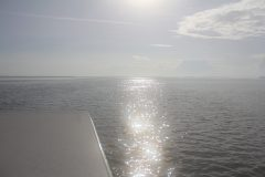 Stunning silver sea meets a noon sky aboard small boat in the Florida Keys. Photo Credit: NOAA.