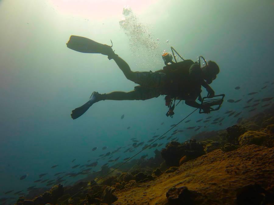 Gideon Butler of the University of San Diego lays a transect along a reef. Photo credit: Lauren Valentino, NOAA