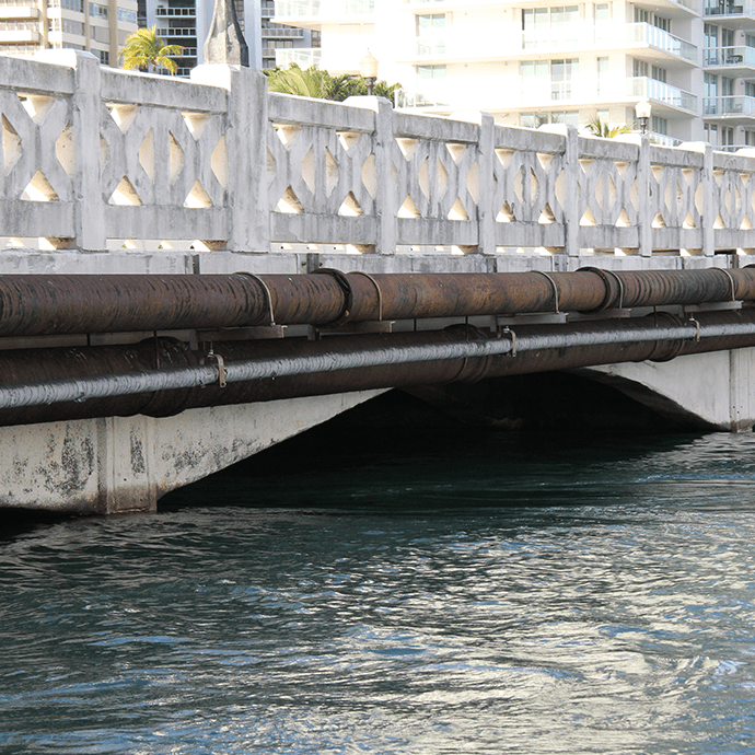 King Tide: tide at 8:30am marks a before with low watermark on a bridge in Coconut Grove