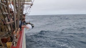 A drifting buoy being deployed from the Bark Europa off South Africa (credit: NOAA/AOML).