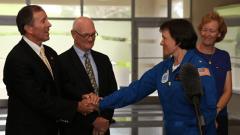 Rear Admiral Anita Lopez shakes hands with Bermuda Premier Michael Dunkley. Image credit: NOAA