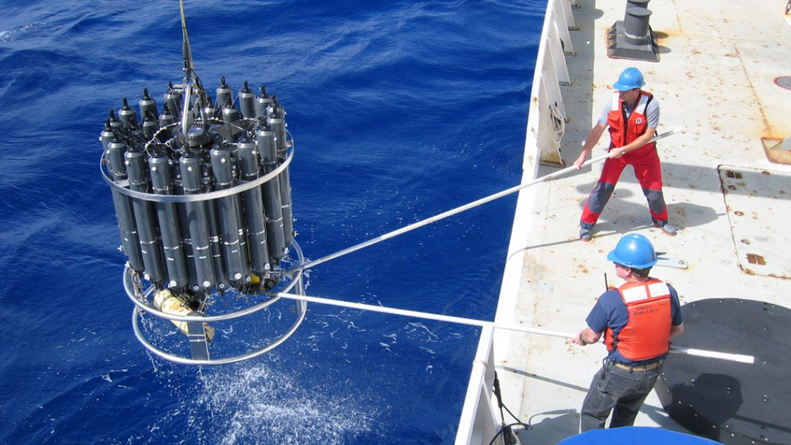 Scientists lift a CTD rosette on board to collect ocean carbon samples. image credit: Nicolas Gruber, ETH, Switzerland