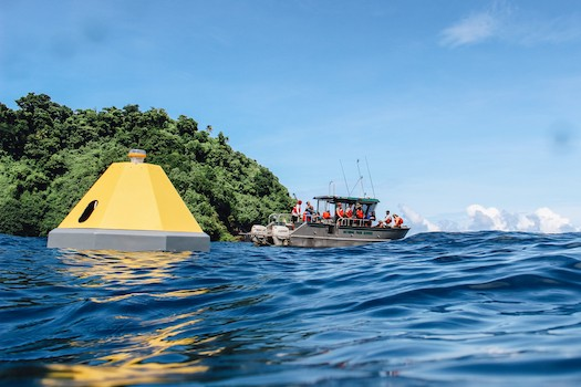 National Park Service staff visit the newly deployed ocean acidification buoy in Fagatele Bay, in the National Marine Sanctuary of American Samoa.