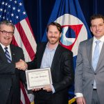 Dr. Luke Thompson (center) is congratulated by OAR Assistant Administrator Craig McLean (left) and Stuart Levenbach of NOAA's Office of the Under Secretary/ Administrator (right) at the OAR Awards Ceremony in Silver Spring, Maryland on March 12.