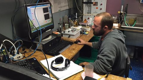 Analysis goes on 24 hours. Andrew Stefanick on the night shift. Image credit: NOAA
