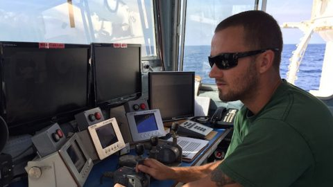 Ethan Irons is one of the three crew running the winch to owed the CTD, The crew runs 24 hour watches: 4 hours on and 8 hours off. Image credit: NOAA.