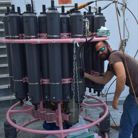Preparing the CTD rosette and niskin bottles for a cast. Image credit: NOAA