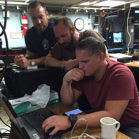 The team reviewing the CTD data on R/V Endeavor. Image credit: NOAA