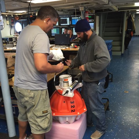 Preparing an inverted echo sounder for deployment. Image credit: NOAA