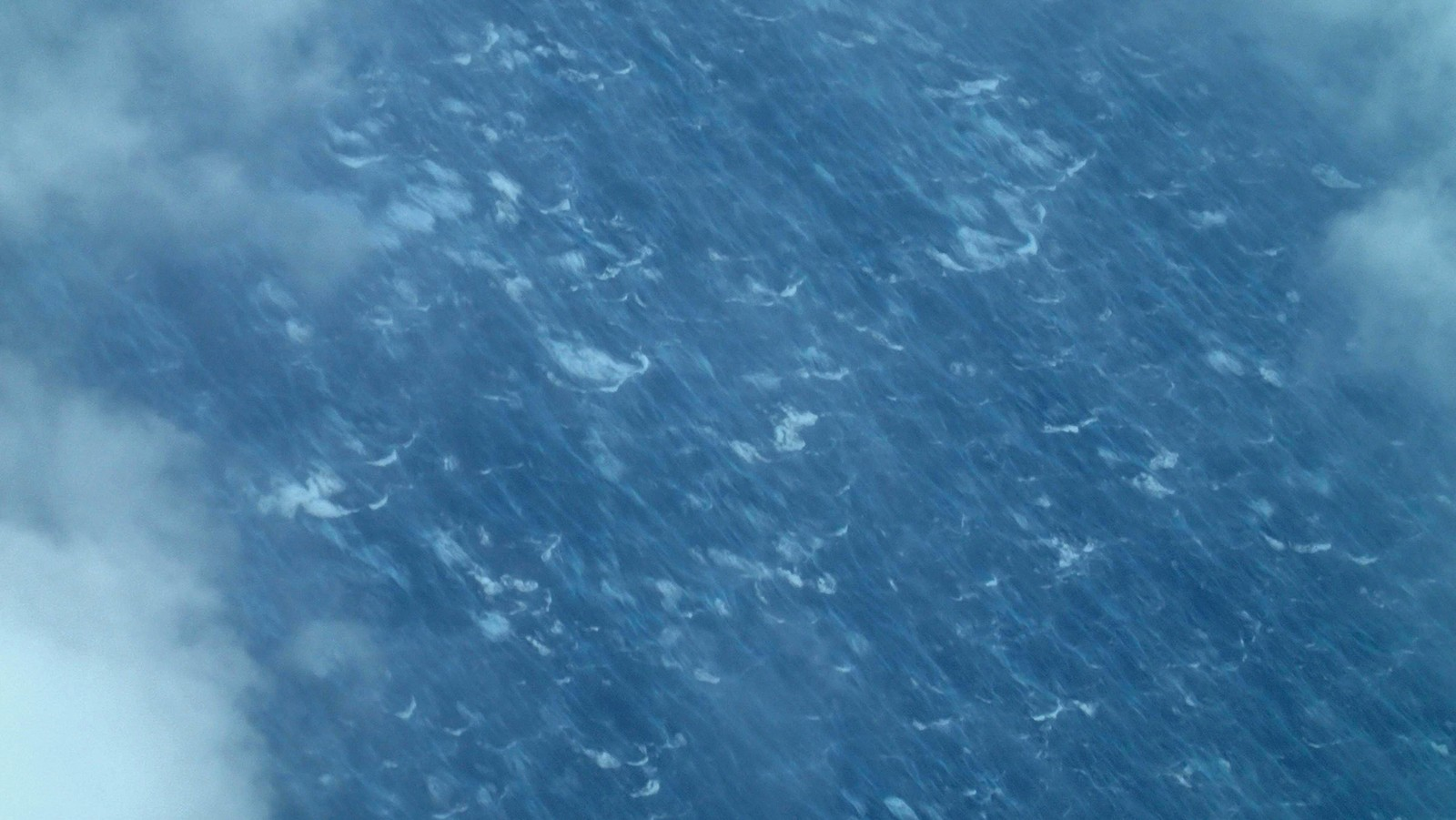 Wind streaks and whitecaps on the ocean surface from Hurricane Edouard's 65 kt winds. Image credit: NOAA