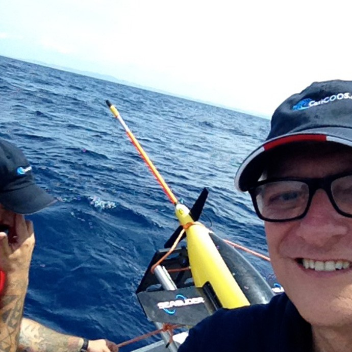 AOML's Principal Investigator, Dr. Gustavo Goni, takes a selfie with the glider before deployment. Image credit: NOAA