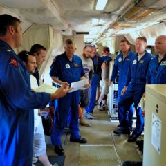 Pre-launch schedule and safety briefing on the P3 Hurricane Hunter aircraft. Image credit: NOAA