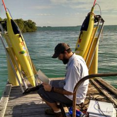 Grant Rawson tests the technological equipment before deploying the two underwater gliders. Image credit: NOAA