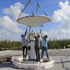 The reflector is lowered onto the positioner. Image credit: NOAA
