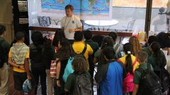 AOML researcher discusses ocean currents with a group of students. Image credit: NOAA