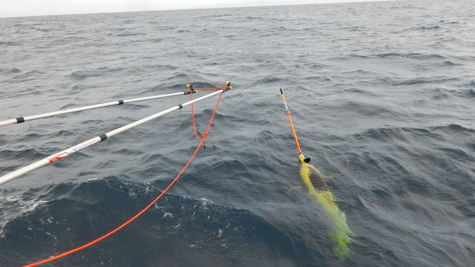 Underwater glider being recovered in the Caribbean Sea. Image Credit: NOAA
