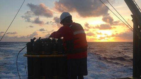 AOML scientist Robert Roddy hoses down the CTD after its final deployment of the day. Image credit: NOAA