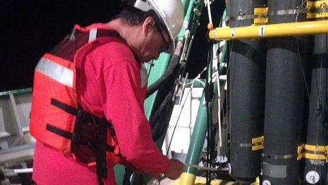 AOML scientist Robert Roddy takes a sample from a CTD cast. Image credit: NOAA.