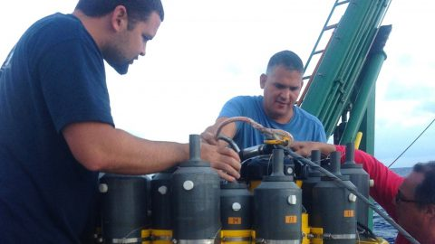 AOML scientists Erik Valdes, Pedro Pena, and Robert Roddy check on the CTD equipment prior to deployment. Image credit: NOAA