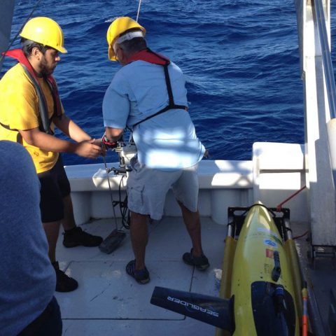 The glider is secured after being brought aboard the R/V La Sultana. Image credit: NOAA