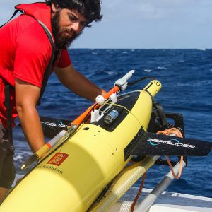 Scientists and crew get ready to send the underwater glider into the ocean. Image credit: NOAA