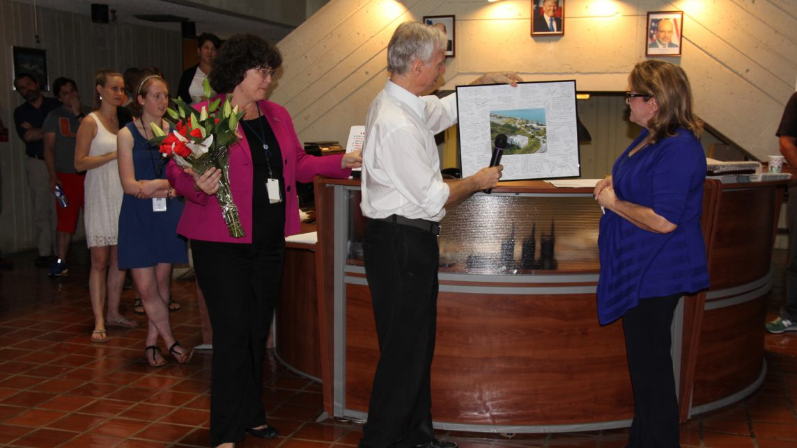 Dr. Atlas presents Gladys with a gift. Image credit: NOAA