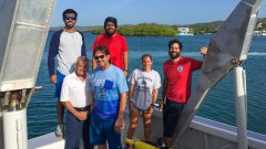A group of scientists poses for a photo after a successful glider deployment. Photo Credit: NOAA AOML