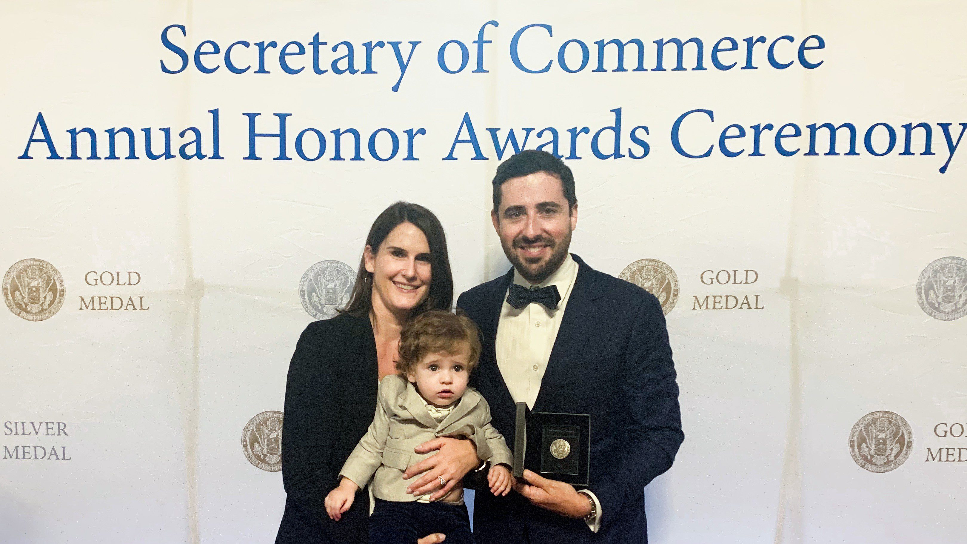 Ian Enochs, pictured with his wife and son, awarded with the DOC Silver Medal Award.