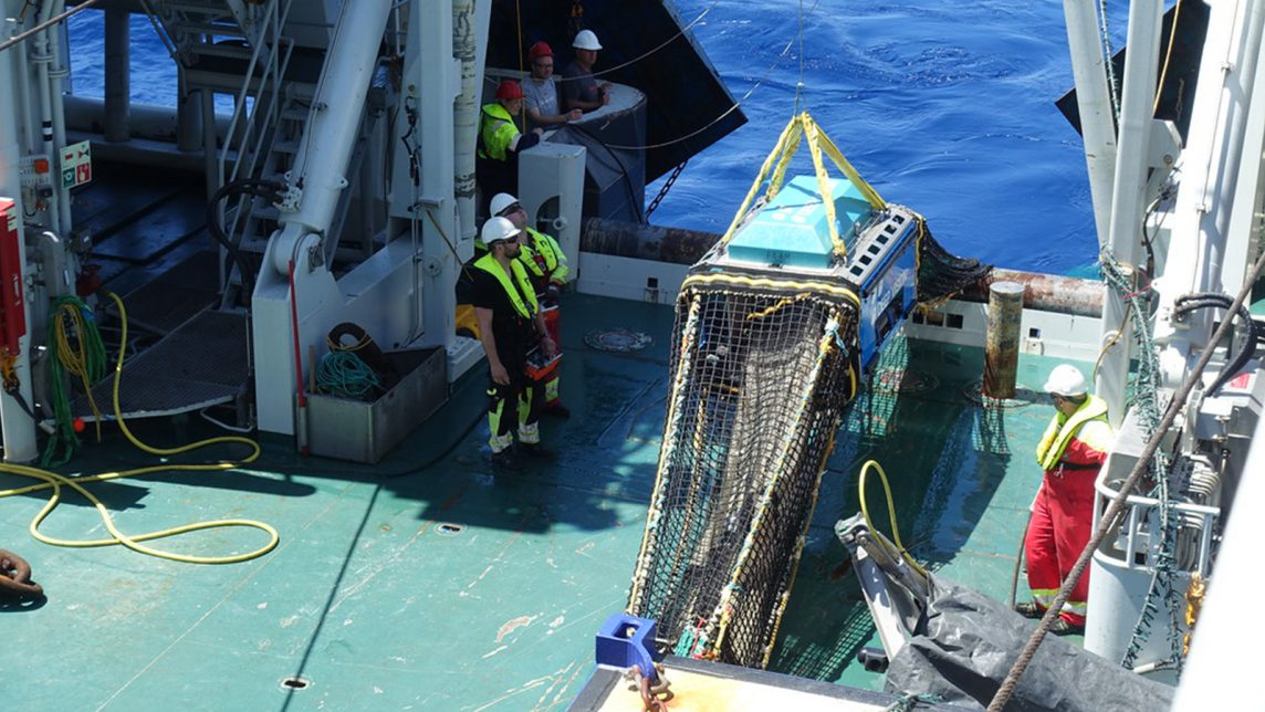 A macroplankton trawl equipped with Deep Vision, a camera system that gathers continuous images of passing organisms, is brought on deck after gathering fish from the mesopelagic zone.