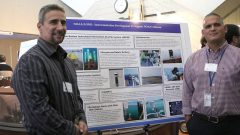 Ulises Rivero and Pedro Peña at poster session during 2019 lab review. Photo Credit: NOAA AOML. Uli Riverio and Pedro Peña at poster session during 2019 lab review. Photo Credit: NOAA AOML.