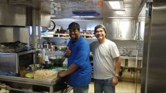 Cooks Emir Porter and Orcino Tan during lunch preparation. Photo Credit: NOAA.