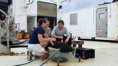 "Setting up oxygen change experiments in a mini ""ocean"" on deck. Photo Credit: NOAA."