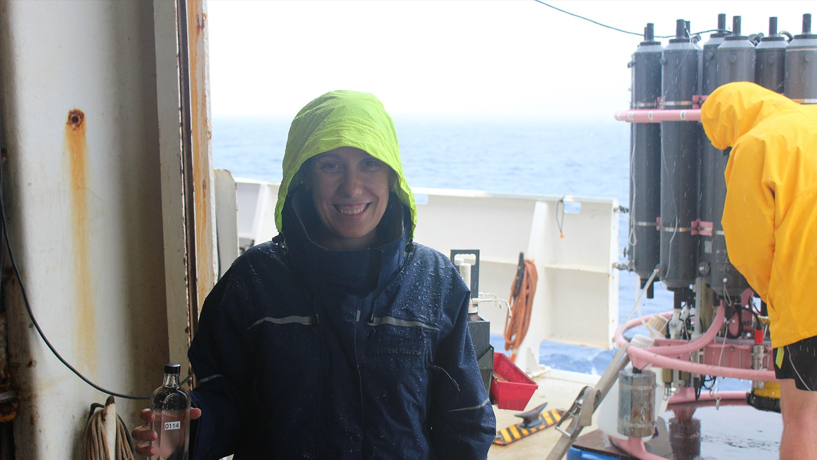 Leticia Barbero (University and Miami and NOAA AOML), chief scientist on the Gulf of Mexico and East Coast Carbon Cruise, holding a sample from the CTD.